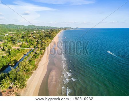 Aerial view from drone of long sandy beach and greenish sea Thailand