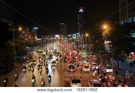 HANOI VIETNAM - NOVEMBER 24, 2016: Heavy traffic street cityscape Hanoi