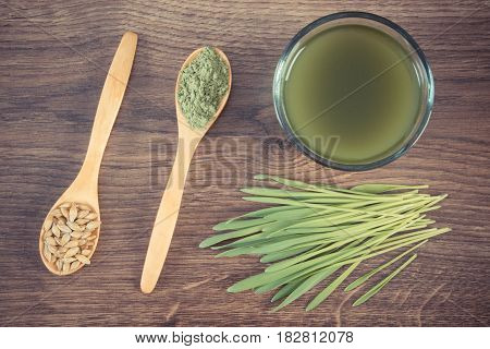 Vintage Photo, Barley Grass With Beverage And Grain With Young Powder Barley On Spoon