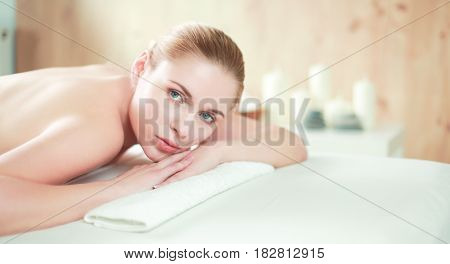 Young woman getting spa massage, lying on spa salon