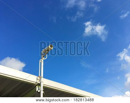 CCTV security camera on the beautiful blue sky background