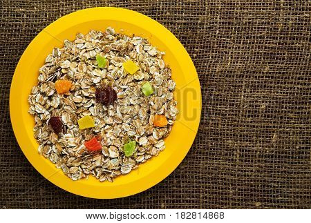 Oatmeal With  Dried Fruit (strawberries, Grapes, Kiwi, Peach). Oatmeal On A Wooden Table. Oatmeal To