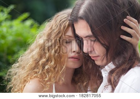 Romantic Young couple in love at nature