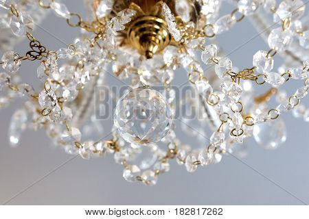 a Details of a crystal chandelier close-up