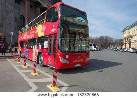 SAINT PETERSBURG, RUSSIA - APRIL 10, 2017: The red double-decker tour bus