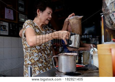 330 Phan Dinh Phung street, Ho Chi Minh city, Viet Nam - FEB 7: Unidentified woman with private business at home by cafe store. Coffee is favorite drink at Vietnam