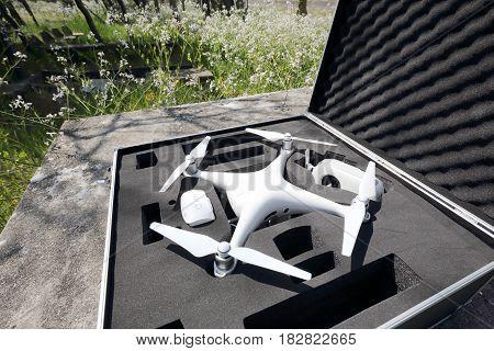KAGAWA, JAPAN - APRIL 22, 2017: White drone Dji Phantom4 Pro stay in metal bag and ready to fly.