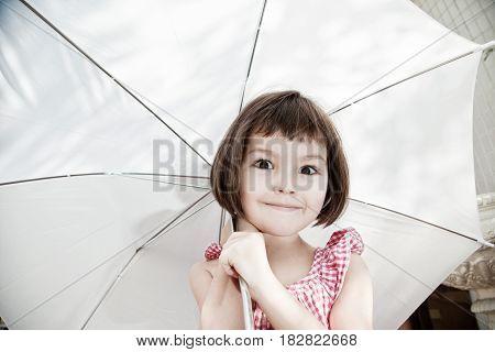 Portrait of asian beautiful girl with umbrella