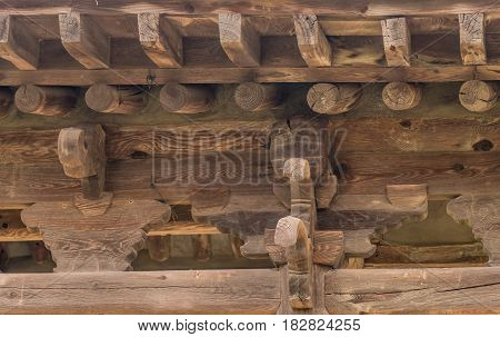 View of underside of roof of an old unused oriental pavilion in a wooded area in South Korea.