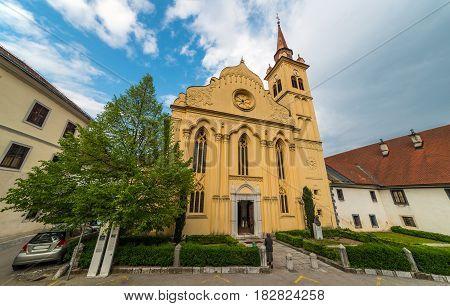 Novo Mesto - April of 2014, Slovenia: Old Yellow Catholic Church in Novo Mesto, Parish Church of Saint Lenart