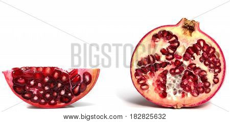 Fresh juicy pomegranate pieces on white background