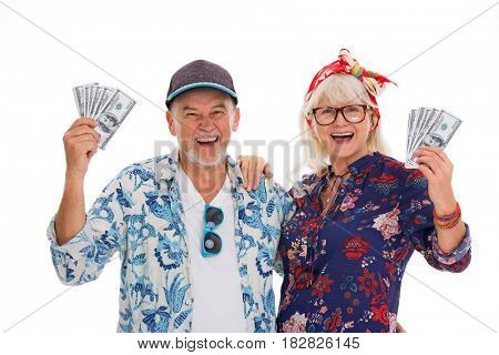 Smiling senior couple holding money