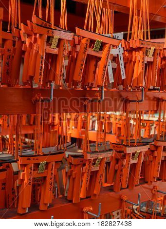 KYOTO JAPAN -NOVEMBER 22 2016: Torii (Gate in Shinto Shrines) shaped Ema which is a smal wooden plaque for the prayers to write their wishes at Fushimi Inari Taisha Shrine in Kyoto, Japan