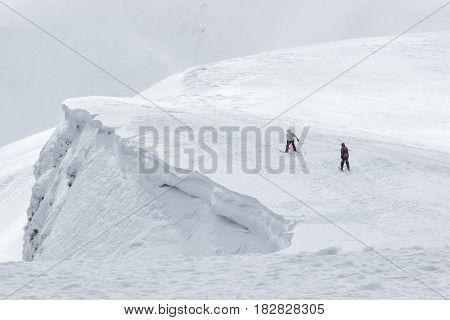Freeride skier with rucksack running downhill in freeze motion of snow powder.