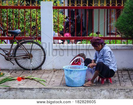 Vendor On Street In Saigon, Vietnam