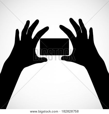 Two hands with fingers spread out and card. Silhouettes. Element for your design.