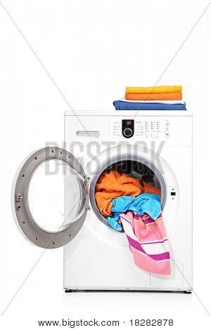 A studio shot of a washing machine isolated on white background
