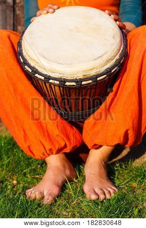 Young lady drummer with her djembe drum