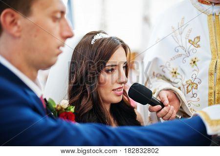 Groom With Bride Take An Wedding Oath At Church On Gospel.