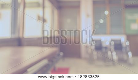 blurred image of room in hospital with wheelchair for background usage.