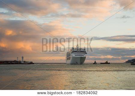 Big ship evening arrival in Yalta port Crimea Ukraine.