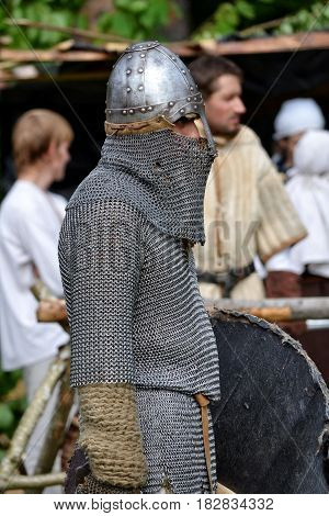 TERVETE LATVIA - AUGUST 13 2011: Historical Zemgalu days. Unknown man dressed in ancient armor with weapons and shield.