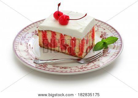 homemade cherry poke cake isolated on white background