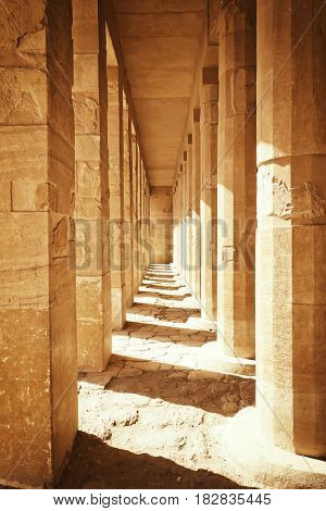 Colonnade of ancient columns at the Temple of Queen Hatshepsut at Luxor (Egypt ). Edited as a vintage photo with dark edges.