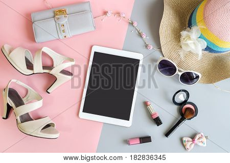 Fashion summer women clothes set with tablet cosmetics and accessories Flat lay Top view copy space