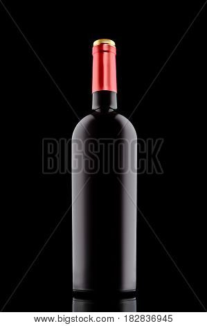 Red wine bottle with red cap at the black backround