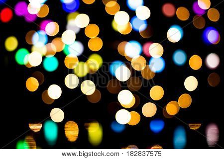 Bokeh background with many light particles on black background