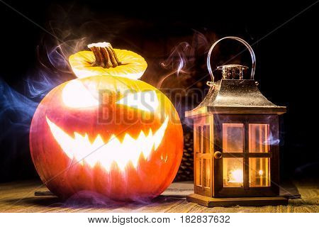 Halloween pumpkin with lantern and mystic smoke