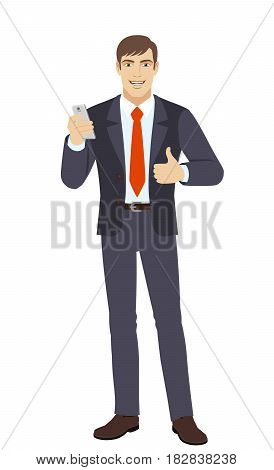 Businessman with mobile phone showing the thumb up. Full length portrait of businessman in a flat style. Vector illustration.