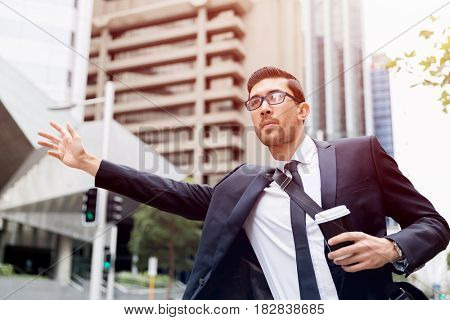 Young businessmen hailing for a taxi