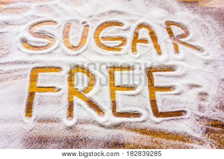 Sugar free sign with wooden table background