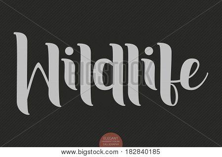 Hand drawn lettering - Wildlife. Elegant modern handwritten calligraphy. Vector Ink illustration. Typography poster on dark background. For cards, invitations, prints etc.