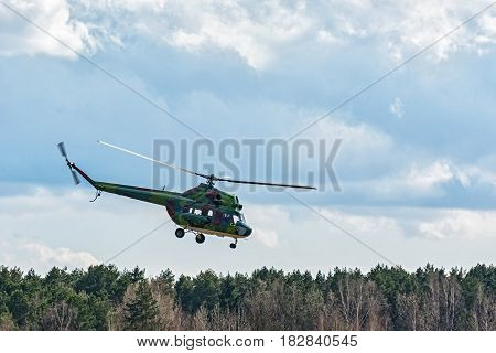 Russia, Tyumen - 15.04.2017: The helicopter MI-2 carries out a control flight around the forest belt