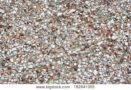 Close up image of a pebbledash wall