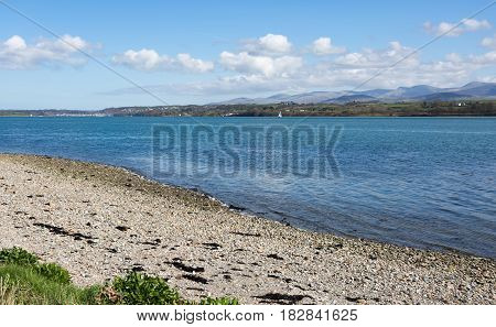 Menai straits in Anglesey North Wales with distant views of Snowdonia National Park
