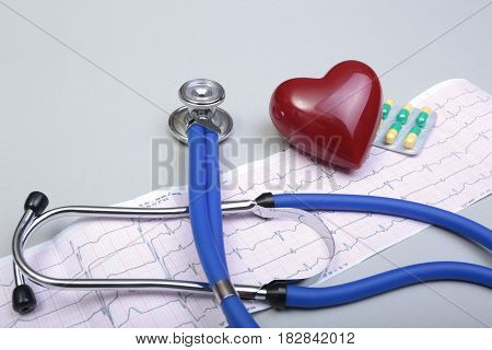 RX prescription, Red heart, asorted pils and a stethoscope on white background.