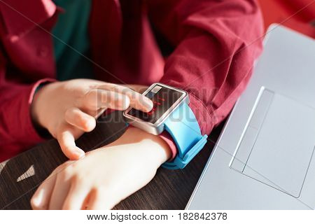 A Close-up Of Child`s Hands With Smart Watch. Touching Electronic Watch. Wearable Gadget Concept. Sh
