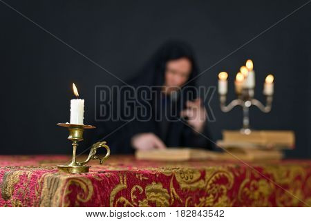 Burning Candle In A Small Brass Candlestick