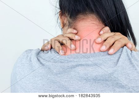 Young woman feeling exhausted and suffering from neck pain Health concept.