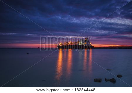 LNG CARRIER IN PORT - Sunrise over the sea