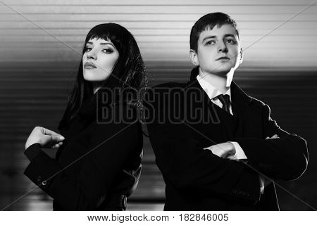 Young fashion business couple in underground tunnel