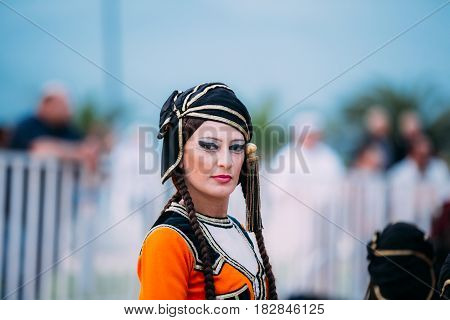 Batumi, Adjara, Georgia - May 26, 2016: Woman dressed in traditional folk costume for Georgian folk dances during the celebration of Georgia's Independence Day.