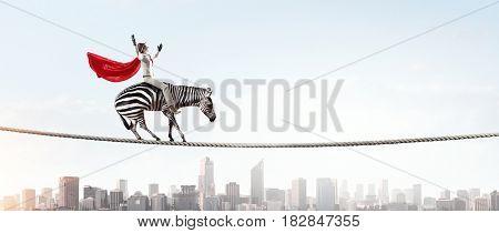 Businesswoman riding zebra. Mixed media . Mixed media