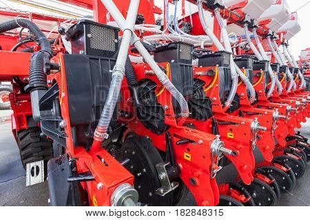 A new red agricultural seeder close up