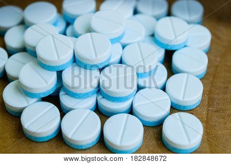 Paracetamol tablets white and blue on the wooden table
