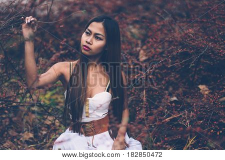 Portrait of beautiful wiccan girl in the forest